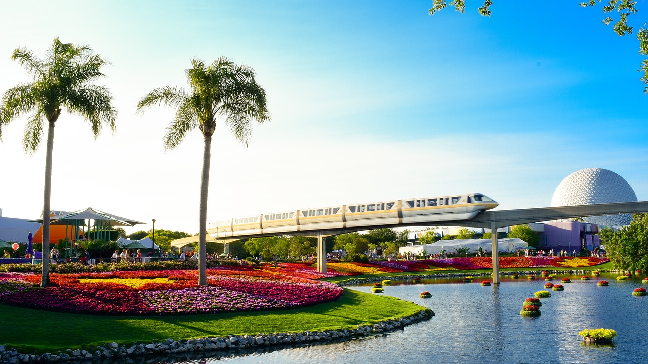 A train zooms over a Disney World park