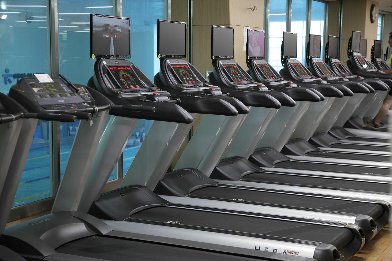 A line of treadmills at a fitness studio