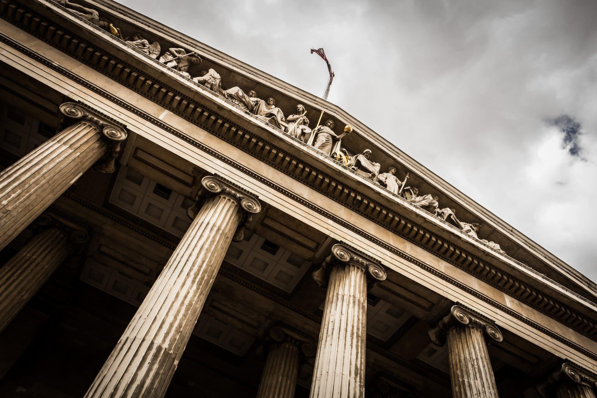Courthouse pillars against a cloudy sky