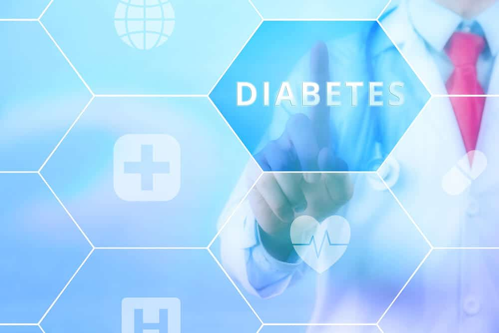 Medical doctor pressing 'Diabetes' button on virtual touch screen on blue technology background